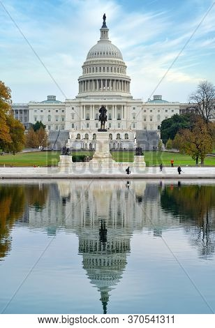 Washington, D.c., Usa - November 12, 2017: Reflections Of The United States Capitol Building And The