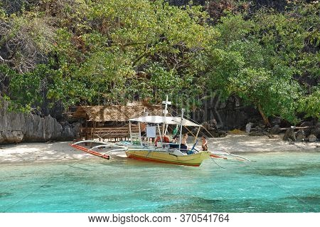 Palawan, Ph - March 7 - Bbh Beach Boat And Hut On March 7, 2012 In Coron, Palawan, Philippines.