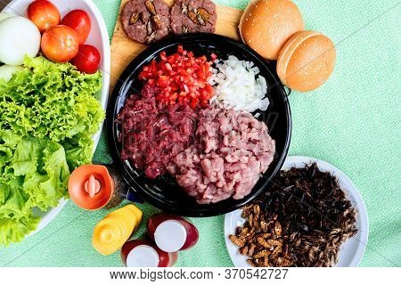 Homemade Hamburger With Beef Or Pork Meat And Insect With Lettuce And Cheese, Vegetables, Sauce And