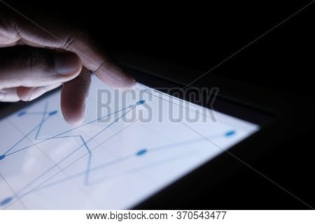 Person Hand Working On Digital Tablet, Close Up