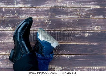 Work Life Balance Concept. Low Section Of A Man Standing With Half Of Working Shoes And Casual Trave