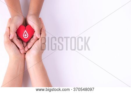 Woman And Child Hands Holding Red Heart  For Blood Donation Concept,world Blood Donor Day, Health Ca