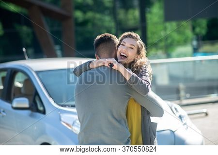 Incredibly Joyful Woman Hugging Man On The Street.
