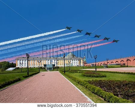 Moscow, Russia - May 09, 2019: Russian Military Aircrafts Fly In Formation Over The Moscow Kremlin D
