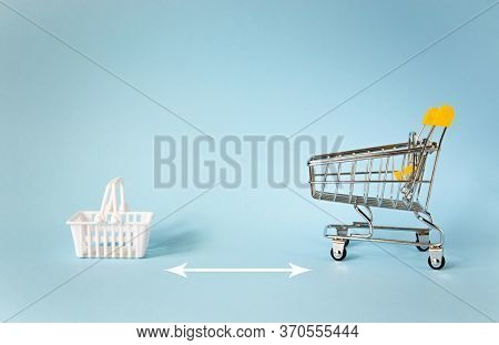 Miniature Shopping Trolley And White Basket Isolated On Blue Background With Copy Space. Empty Minia