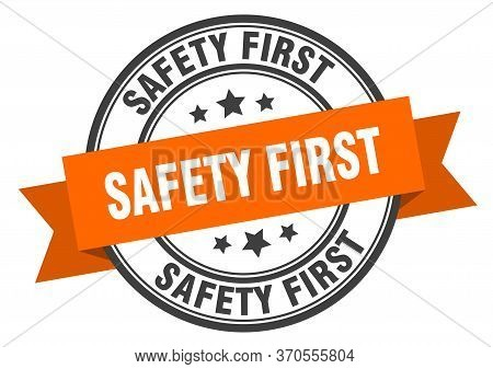 Safety First Label. Safety First Orange Band Sign. Safety First