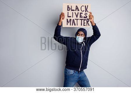 Black Lives Matter Concept. Photo Of Dark Skin African Poor Protester Carry Placard Illegal Communit
