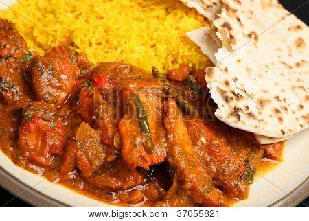 Indian chicken tikka jalfrezi curry with pilau rice and chapati.