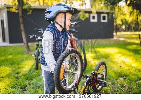 Cyclist Boy Bike Repair. Little Boy Fixing His Bike. Children Mechanics, Bicycle Repair Profession.
