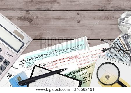 Irs Form 1040 Individual Income Tax Return And W-2 Wage And Tax Statement Lies On Office Table And R