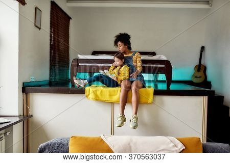 African American Woman, Baby Sitter And Caucasian Little Girl Reading Book, Fairy Tale Together Whil