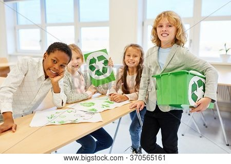 Children of elementary school as environmentalists team are planning a recycling project