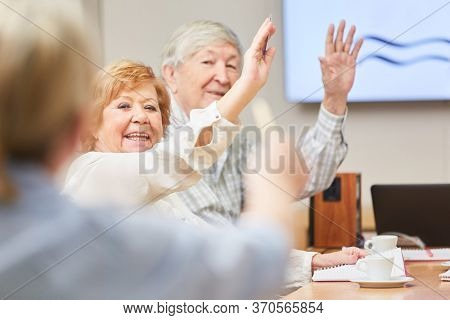 Curious seniors in an adult education seminar at the adult education center