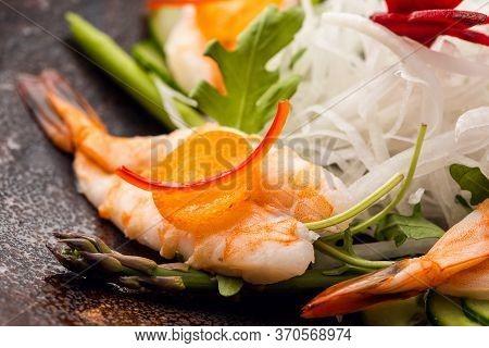 Asian People Eating Sashimi Set In Asian Restaurant. Hirame Sashimi, Salmon Sashimi And Tuna Sashimi