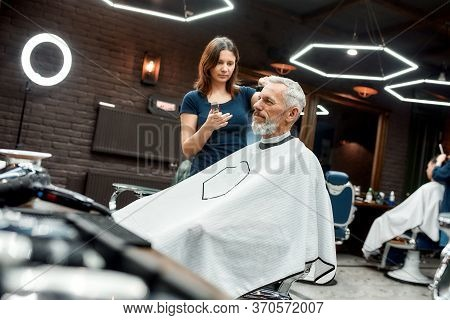 Visiting Hairstylist. Young Professional Barber Girl Using Hair Clipper. Making New Haircut For Eleg
