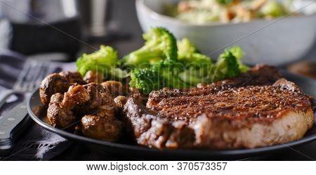 seared ribeye steak with broccoli and sauteed mushrooms