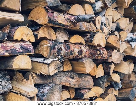 Birch Wood Neatly Stacked In A Woodpile, Close-up, Background, Texture. Preparation Of Firewood And