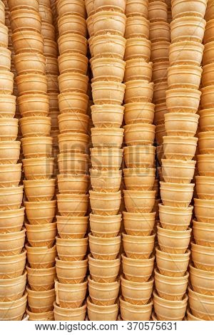 Ice cream cones background. Waffle cones for dondurma ice-cream close-up. Many tasty ice cream cones in icecream shop