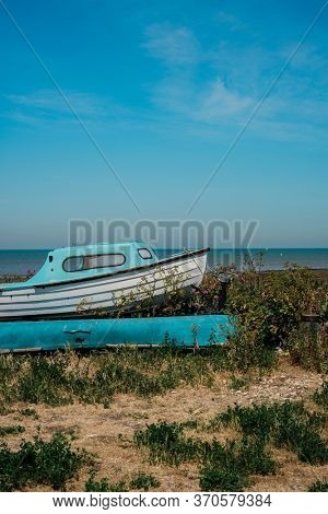 Single boat on a lovely beach in Whitstable, United Kingdom