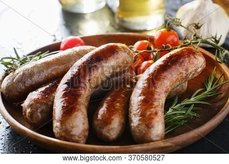 plate of german bratwurst sausages with herbs