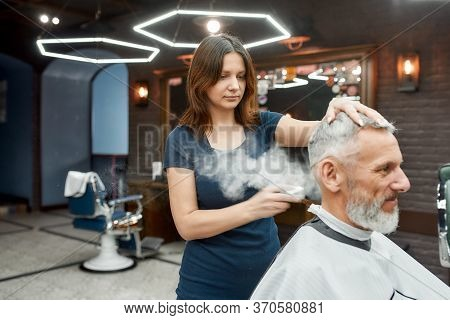 Styling Powder. Mature Man Visiting Barbershop. Young Professional Barber Girl Is Making Hair Stylin