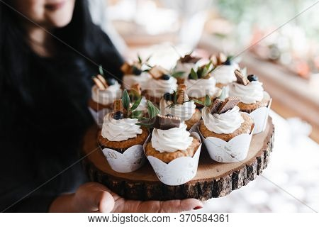 Many Cupcakes Decorated With Cream And Berries On The Piece Of Wood. Wedding Cupcakes