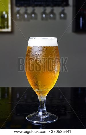 Glass Of Beer, With Pilsen Beer Or Chopp, On A Black Table In A Pub