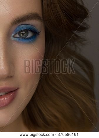 Closeup Of Beauty Woman With Clean Shiny Skin And Natural Cosmetics. Beautiful Extrem Eyelash And Pl