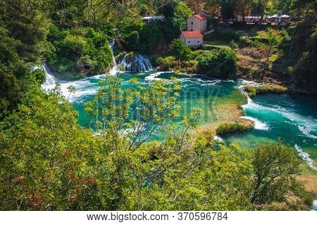 Krka National Park. Waterfalls And Wild Landscape At Famous Tourist Attraction In Croatia