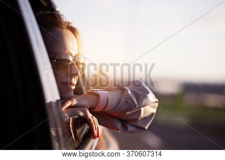 Woman In Sunglasses Riding On Car As Passenger Looking Out Of Window, Enjoy Summer, Freedom, Weekend