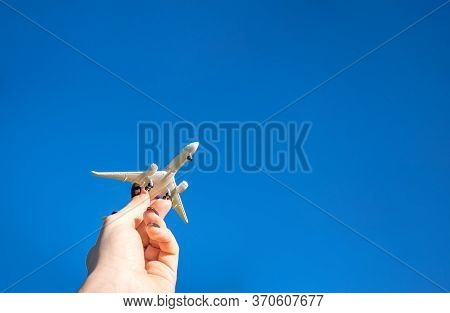 Kids Playing Toys In Sun Light Day. White Plane In Hand Fly In Blue Sunlight Sky. Airplane, Aircraft