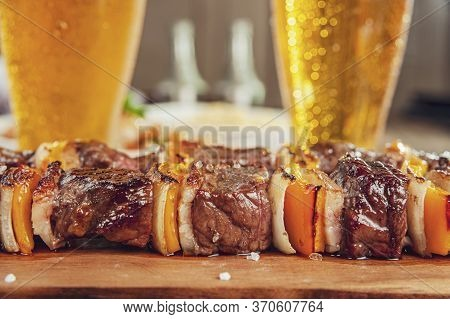 Grilled Meat Stick With Two Glasses Of Beer And Ingredients - Brazilian Espetinho De Carne