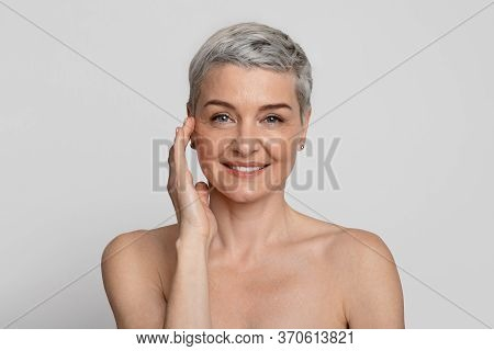 Anti-age Treatment. Portrait Of Attractive Nude Mature Woman With Beautiful Skin Posing At Camera Ov