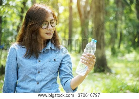 Healthy Woman Holding Mineral Drinking Water In Hands Outdoor Outside Town In Green Park Smile And L