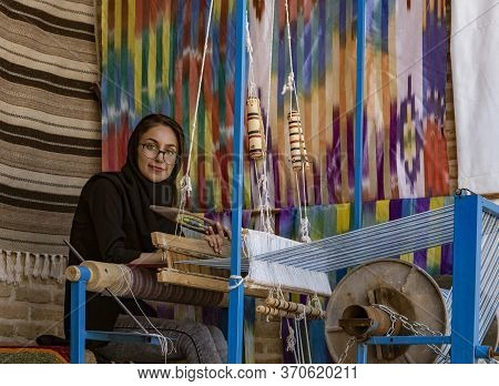 Isfahan, Iran - 2019-04-12 - Woman Weaves Cloth On A Hand Loom.