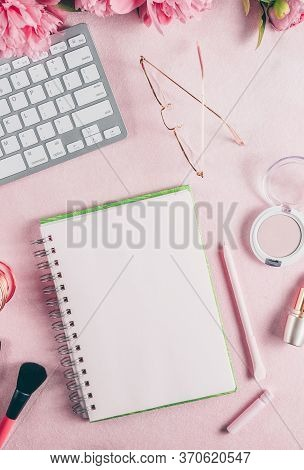 Office Feminine Desk Workspace With Pink Peony, Keyboard, Cup Of Coffee, Cosmetics, Glasses, Lipstic