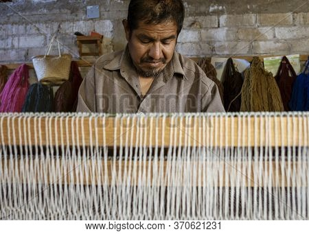 Oaxaca, Mexico - 2019-11-30 - Man Works At His Loom Making A New Blanket.