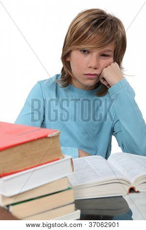 A bored child reading a book
