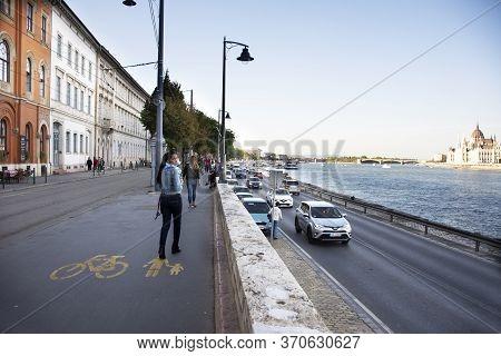 Traveler Thai Women Walking On Footpath Riverside Of Danube River Go To Budapest Chain Bridge And Bu