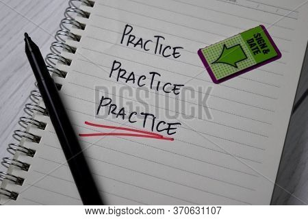 Practice. Practice. Practice Text On A Book Isolated On Office Desk