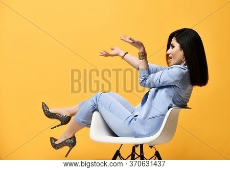 Having Fun Stylish Woman In Official Pantsuit Formal Wear Sitting In Armchair Holding Something On H