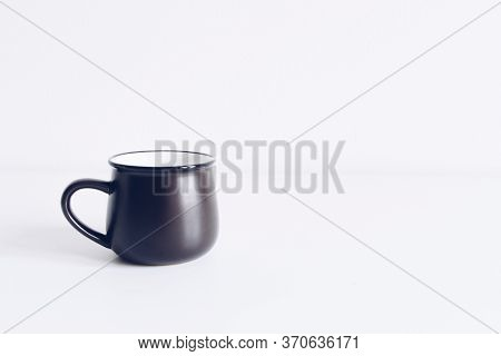 Enamel Black Mug On White Table Background Mock Up. Boho Style Classic Stock Photo. Still Life Compo