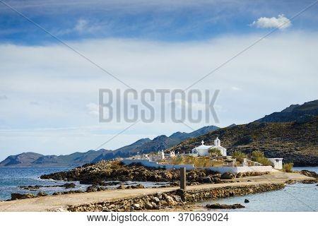 Agios Fokas Region Of Monemvasia. Greek Coastline With Small Cemetery On Sea Shore, Maleas Peninsula