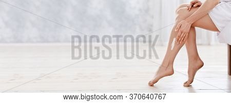 Closeup Of Female Legs, Woman Applying Cream On Her Body At Home, Panorama With Copy Space