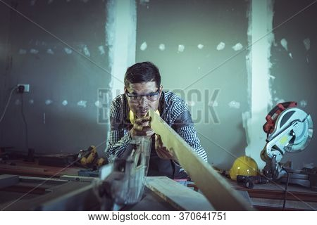 Young Portrait Male Carpenter Working Actively With Wood
