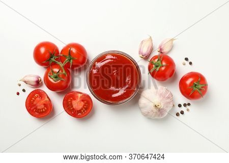 Tomatoes, Sauce And Ingredients On White Background, Top View