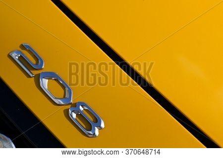 Bordeaux , Aquitaine / France - 05 14 2020 : New Peugeot 208 Gold Logo Sign Yellow Automobiles Car P