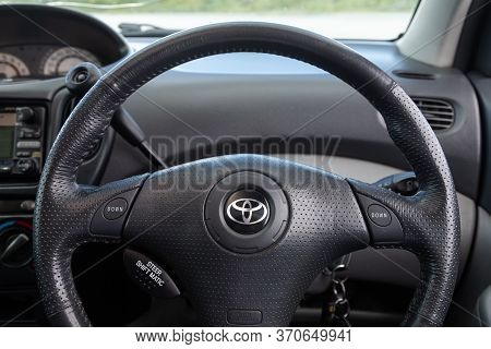 Novosibirsk/ Russia -june  03 2020: Toyota Funcargo ,auto Interior: Steering Wheel With Red Logo  To