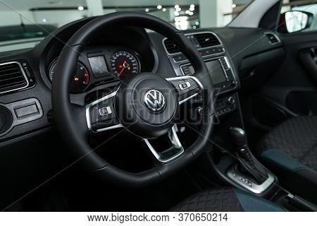 Novosibirsk/ Russia - March 03 2020: Volkswagen Polo, Auto Interior: Steering Wheel With Red Logo  V