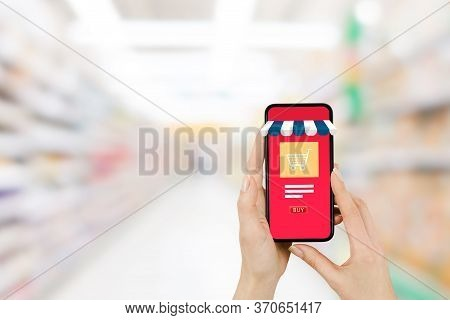 Shopping Online Concept : Hand Holding Smartphone That Showing Shopping Shop Store And Shopping Cart